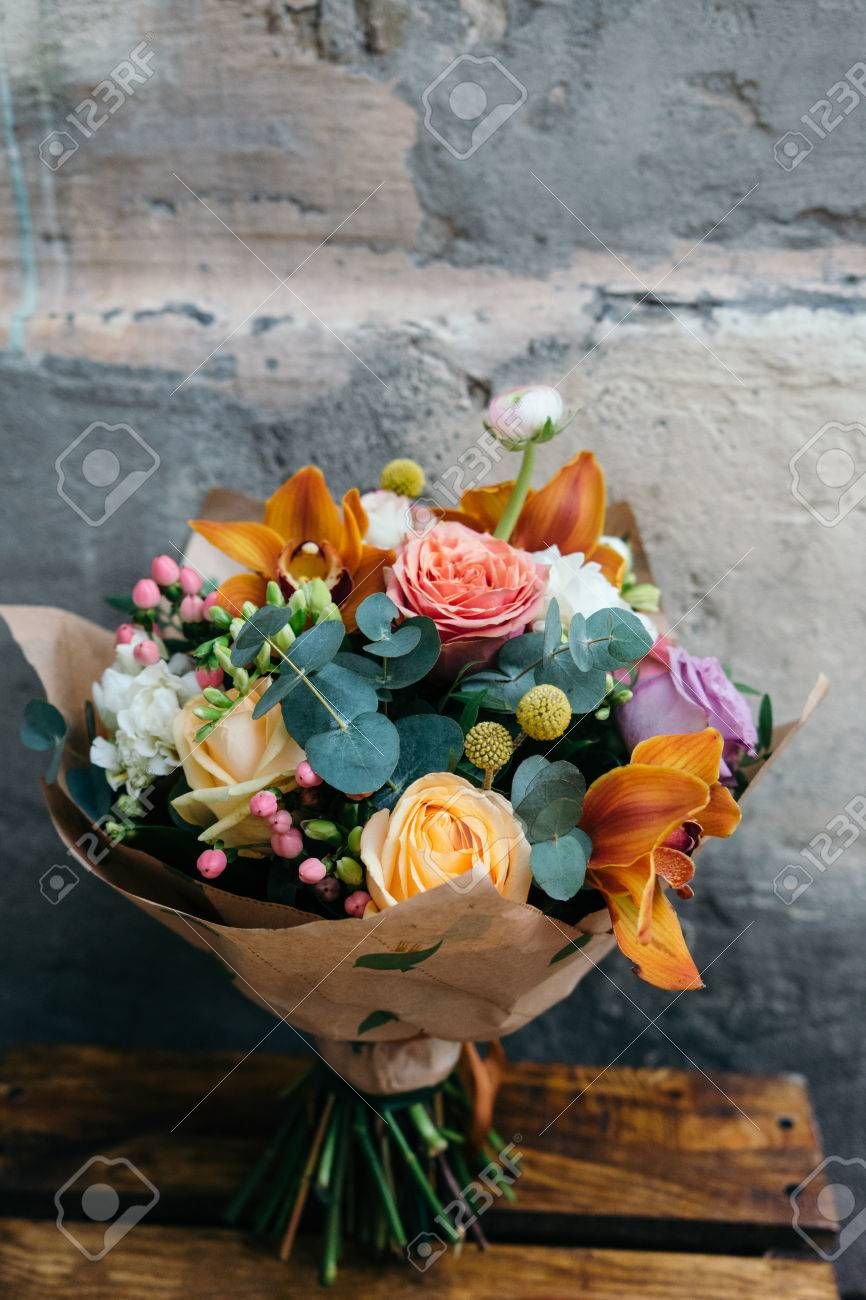 Colorful Bouquet Of Different Fresh Flowers Against Brick Wall Bunch Orchids Roses