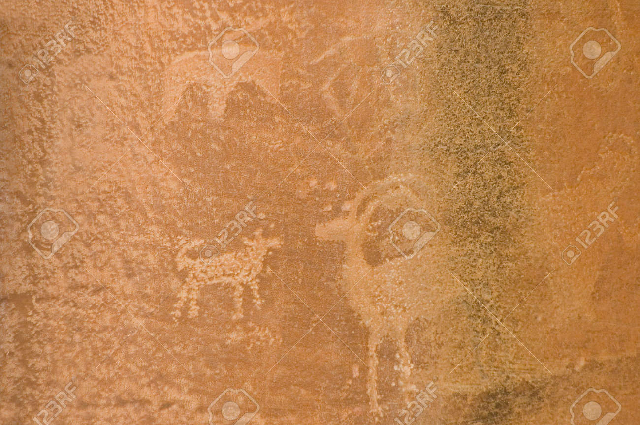 Petroglyph or rock carvings of Indians (Native Americans) on a canyon wall in Utah, USA, representing animals, figures, sheep, snakes, wilderness Stock Photo - 568398