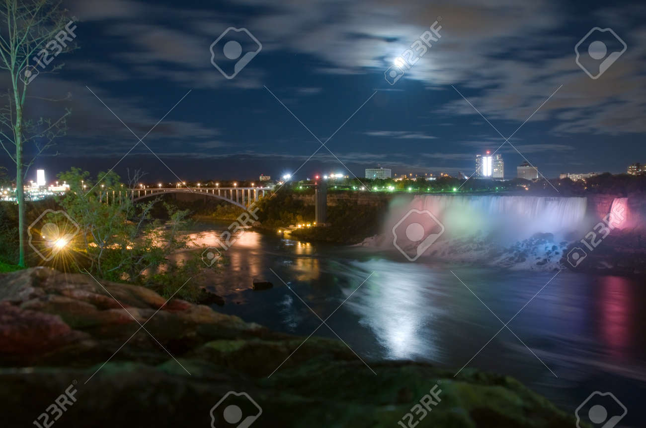 Niagara Falls under moonlight with buildings and  bridge to USA on background, Ontario, Canada Stock Photo - 4178861