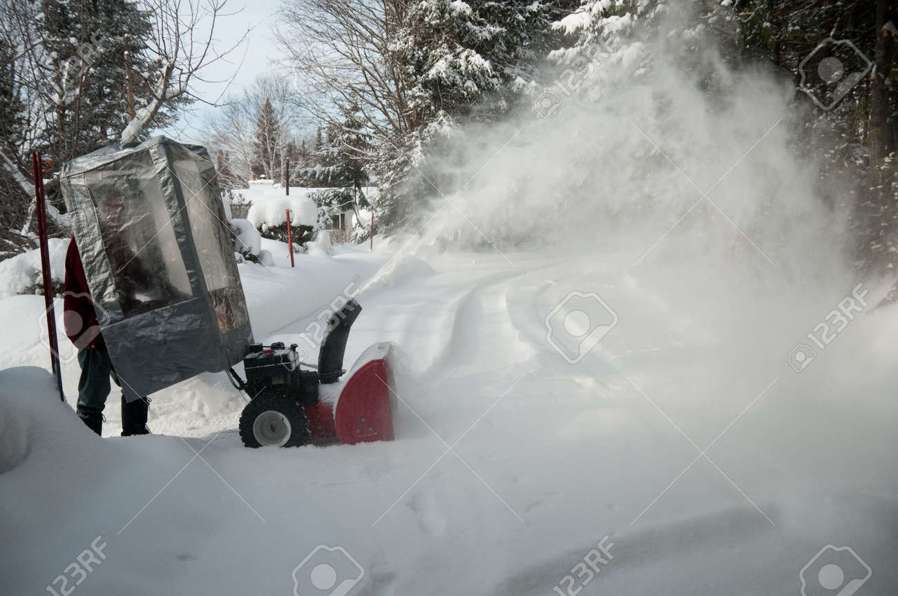 Shelter From Storm With Devices >> Senior Behind A Plastic Shelter With Snow Blower After Storm Stock