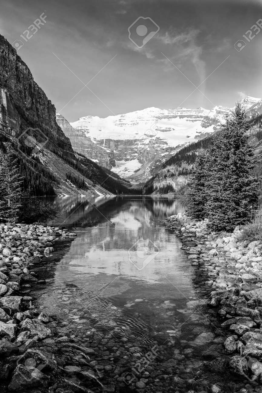 Scenic view with reflections in lake louise in banff national park alberta canada