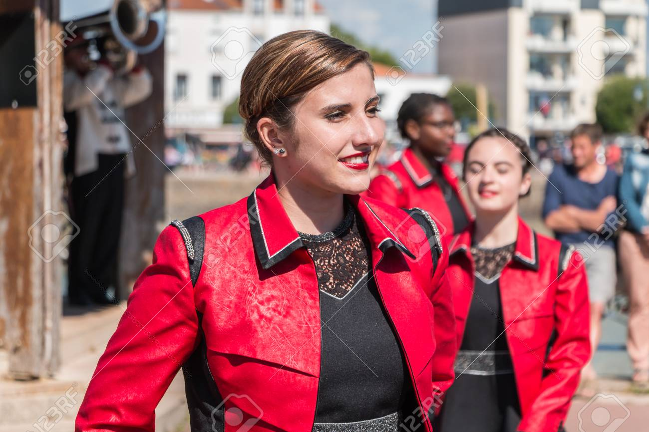 Saint Gilles Croix de Vie, France - July 14, 2016 : portait of fanfare dancing girl in the street that accompanies the musicians during the day of the French national day - 60285696