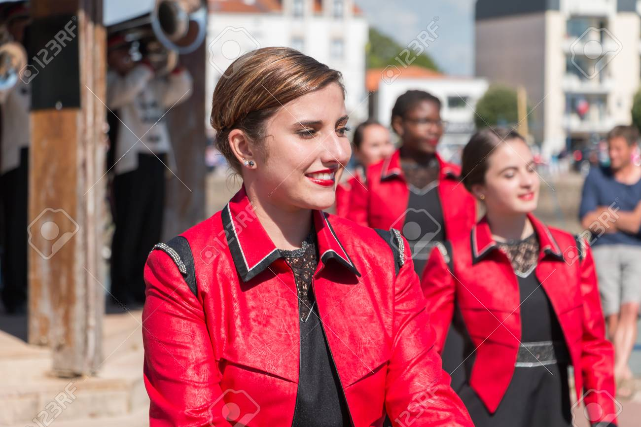 Saint Gilles Croix de Vie, France - July 14, 2016 : portait of fanfare dancing girl in the street that accompanies the musicians during the day of the French national day - 60285701