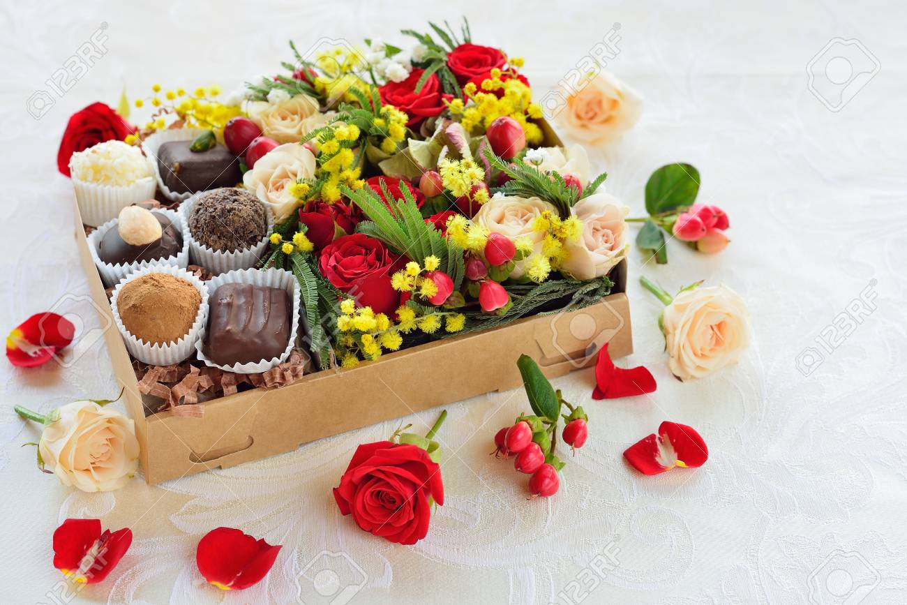 Gift Box With Flowers And Candies Made Of Chocolate Stock Photo