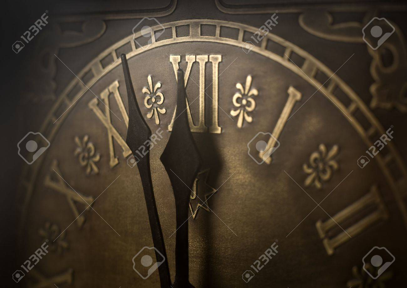 Old clock with roman numerals. Selective focus on  number XII and minute hand. Intentional vignetting. Stock Photo - 2251414