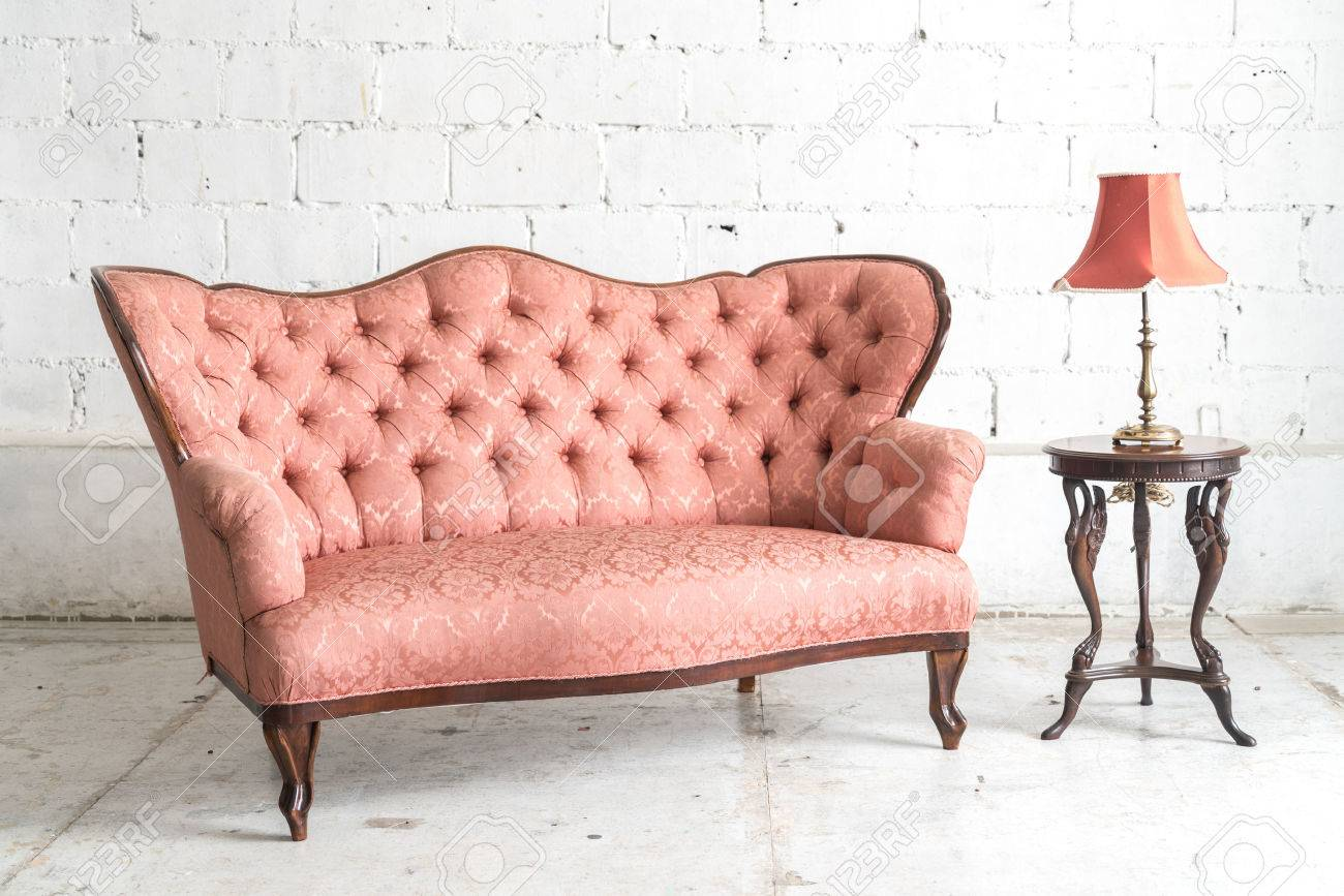 Pink Vintage Sofa And Lamp On White Wall Stock Photo Picture And