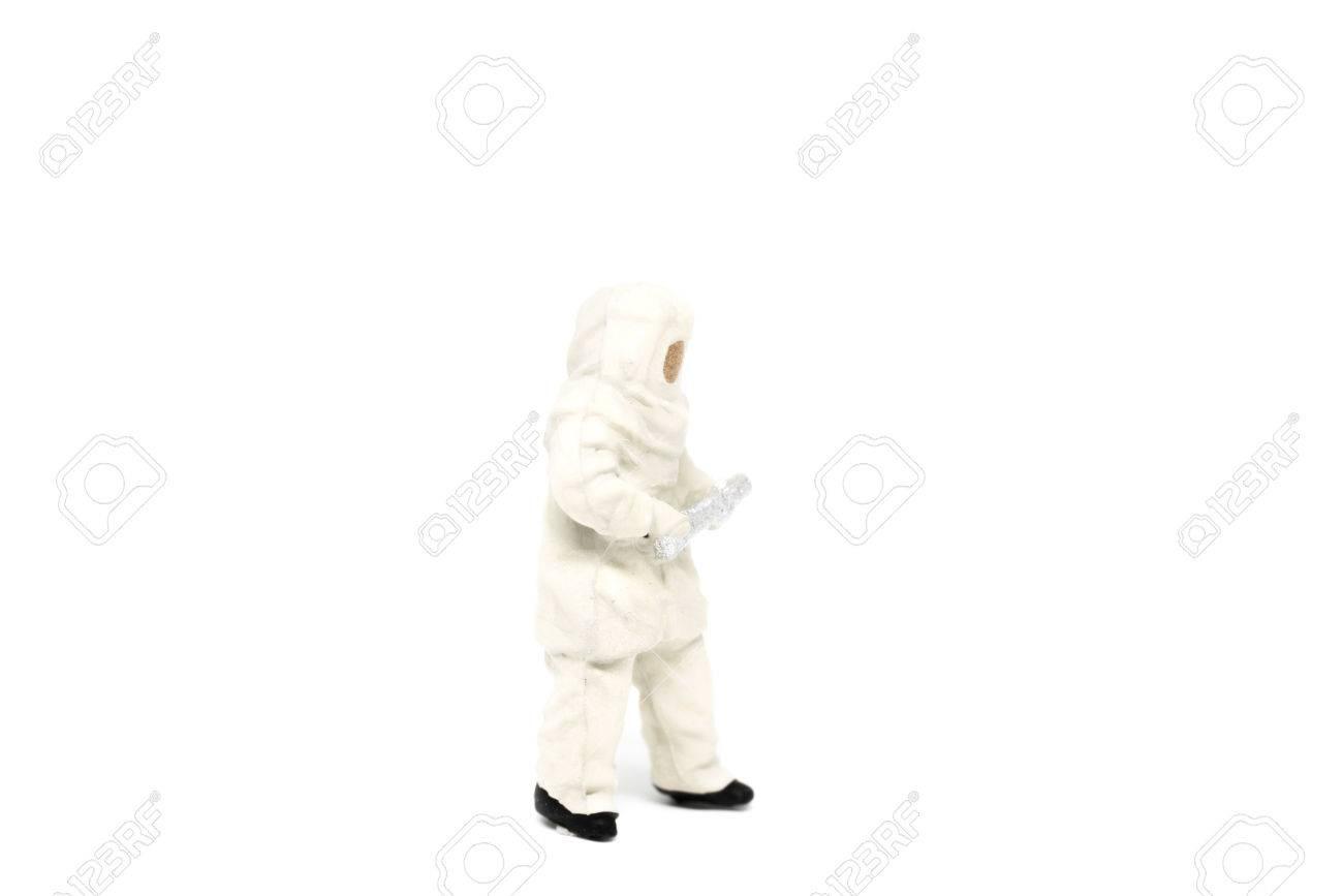 Miniature people firemen in hazmat suits construction concept