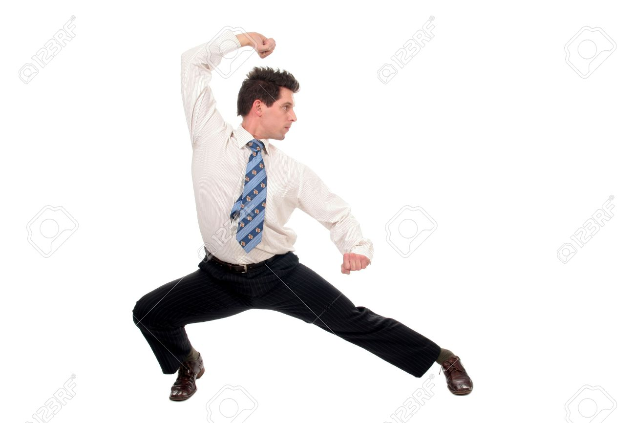 Businessman in kung fu pose Stock Photo - 667675