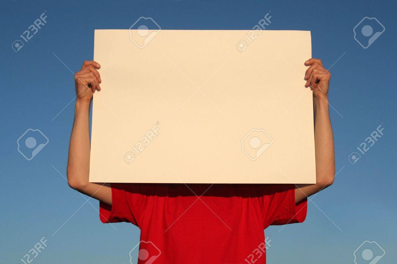 man holding blank poster board stock photo picture and royalty free