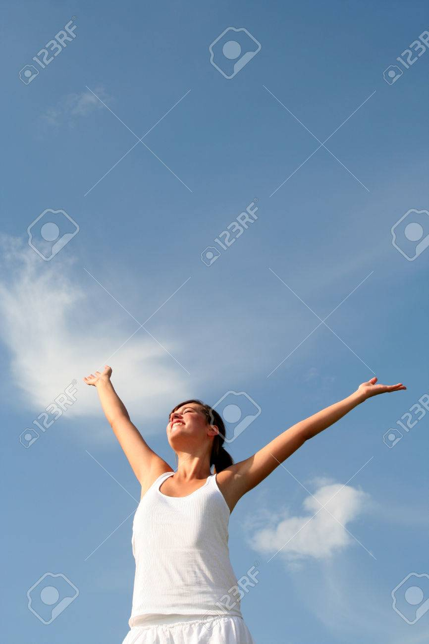 Woman raising arms above her head Stock Photo - 1478816