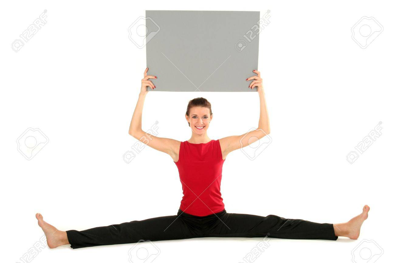 Woman with blank card doing a split Stock Photo - 1952423