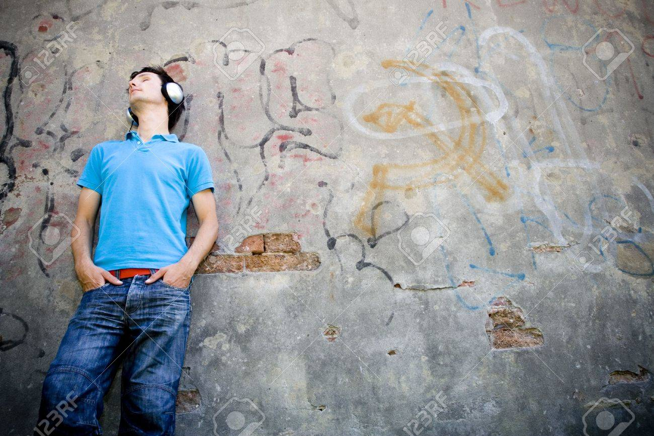 Man leaning against wall with graffiti Stock Photo - 3441023