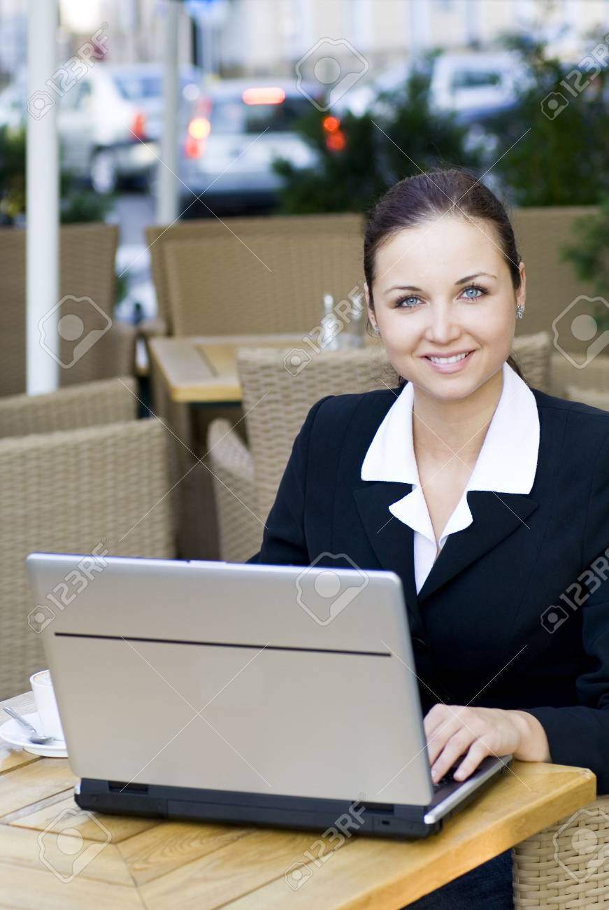 Businesswoman at outdoor cafe Stock Photo - 3453789