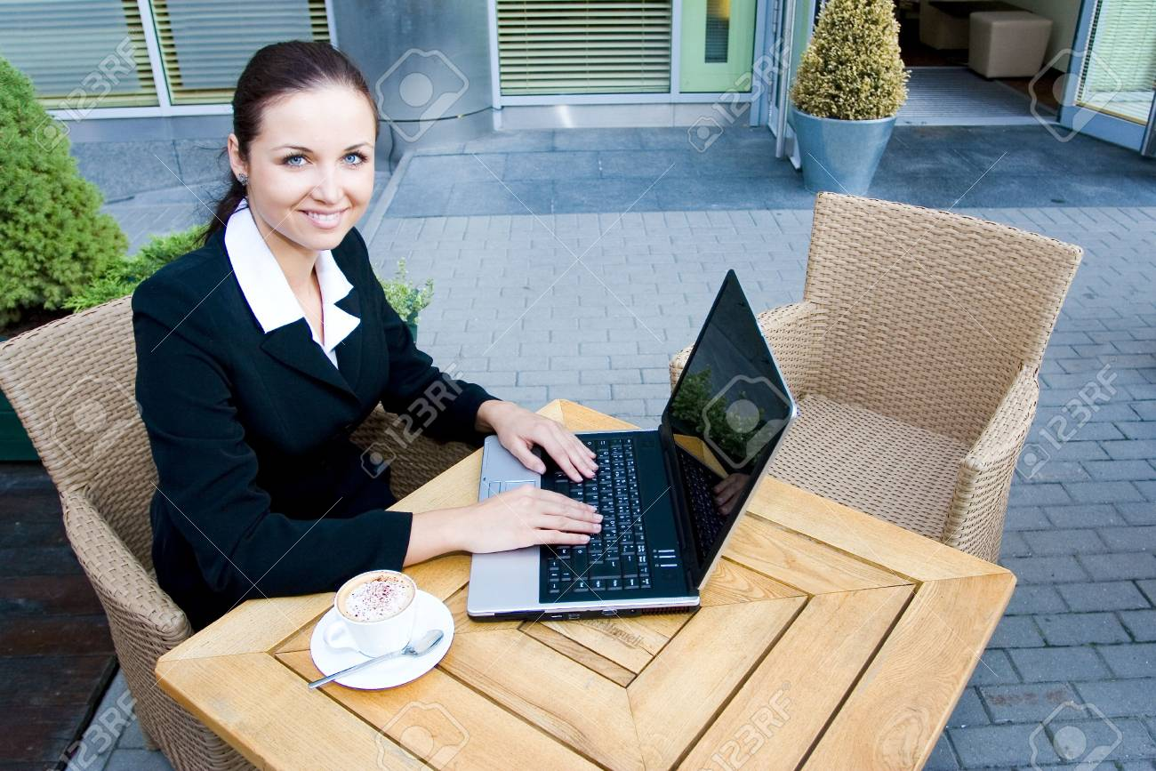 Woman outside a restaurant with a laptop Stock Photo - 3453805