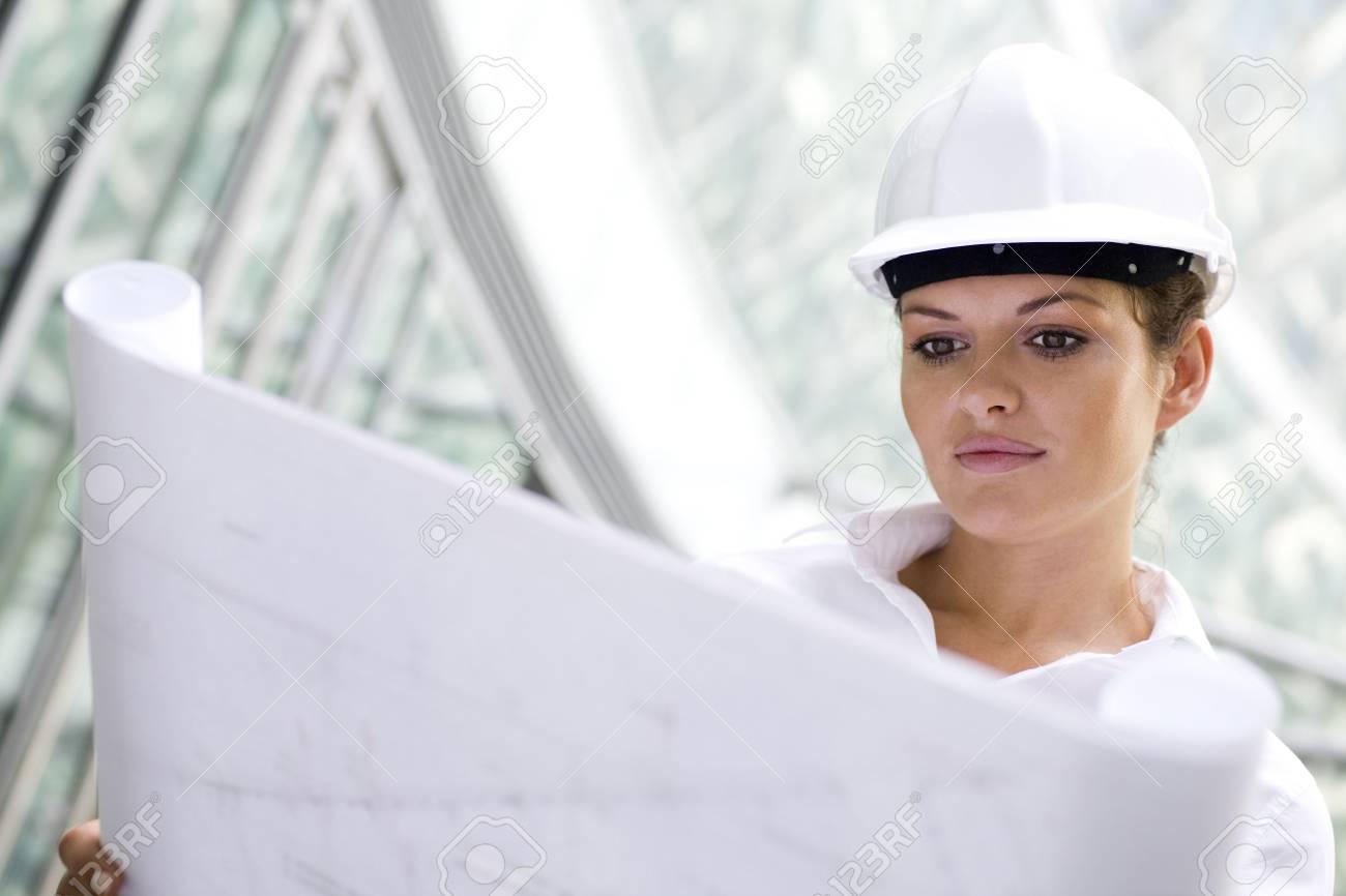 Female architect holding blueprints Stock Photo - 3520562