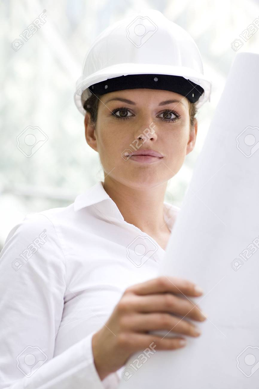 Female architect holding blueprints Stock Photo - 3520563