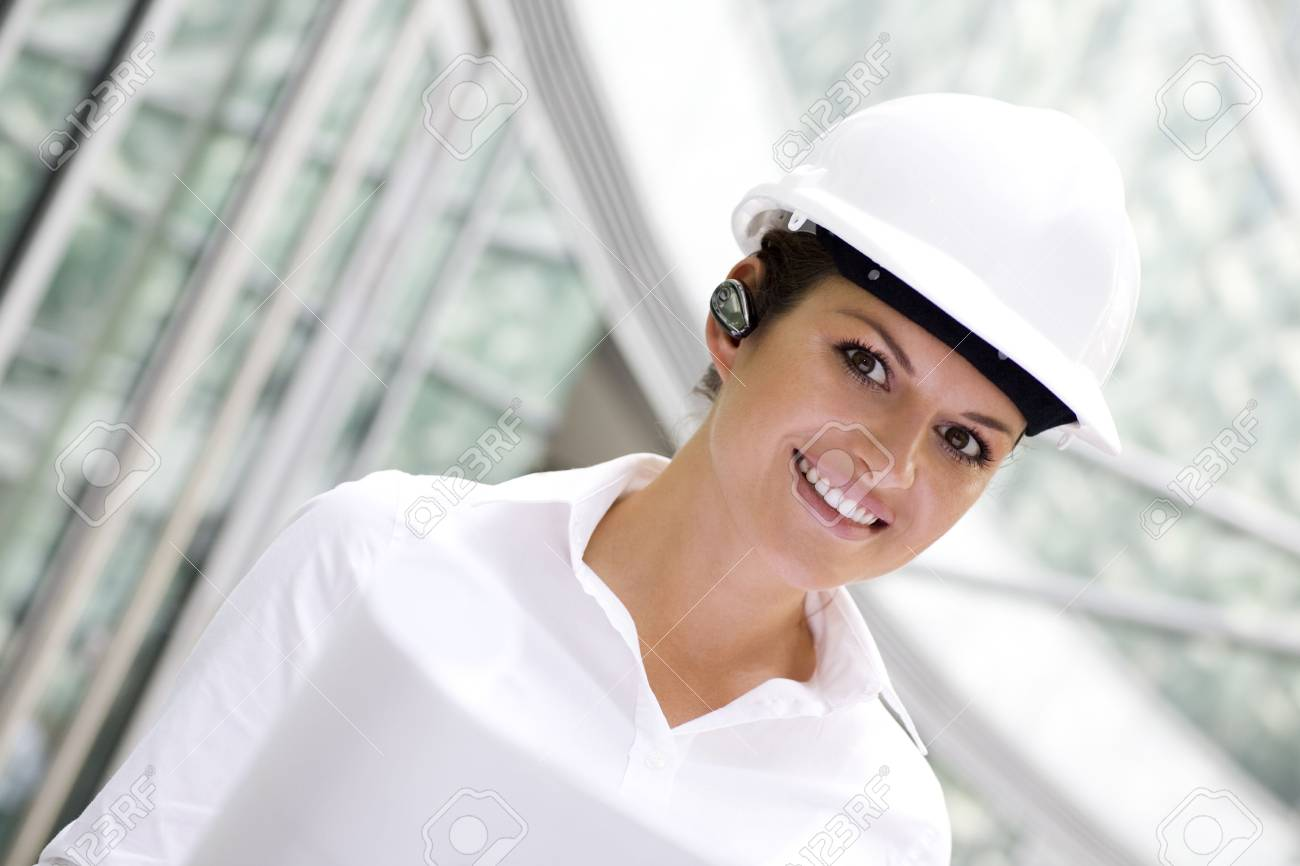 Female architect holding blueprints Stock Photo - 3545150