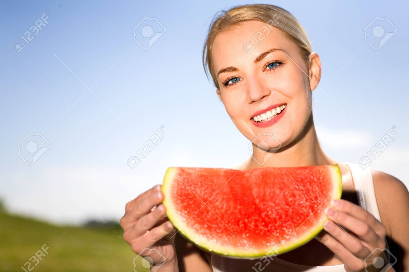 Woman eating watermelon Stock Photo - 4969559