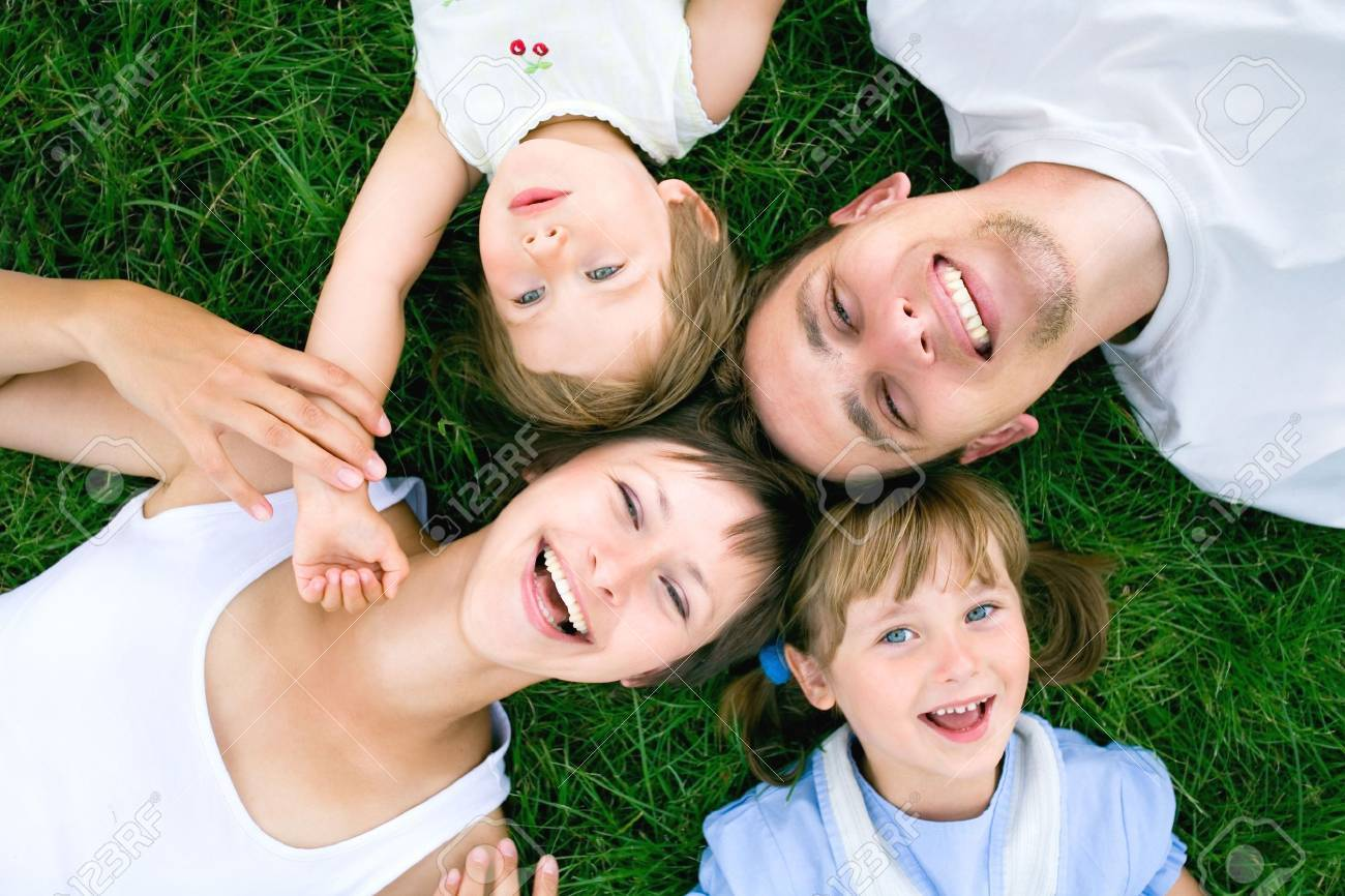 Family lying on grass Stock Photo - 5303231