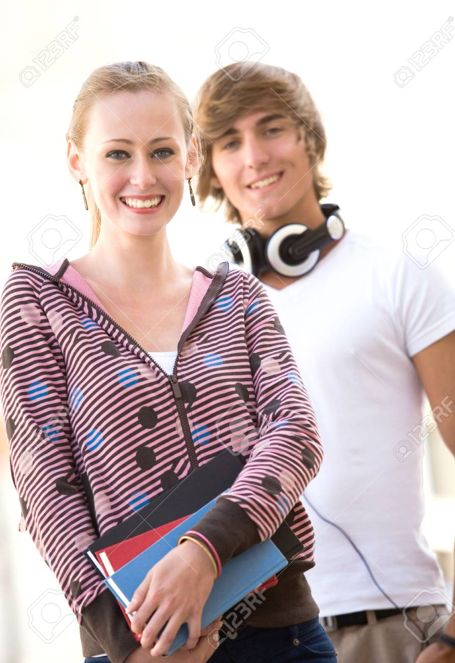 Happy students with books Stock Photo - 5591592