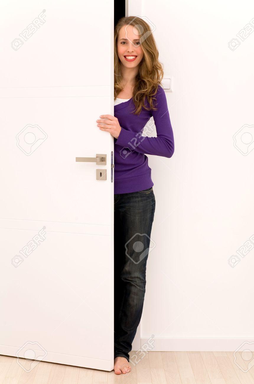 Stock Photo - Woman opening door
