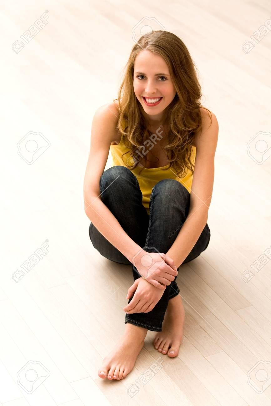 Young woman sitting on floor Stock Photo - 5976262
