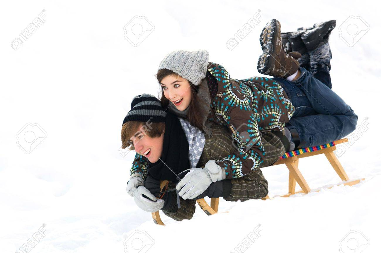 Young couple sledding Stock Photo - 6280747