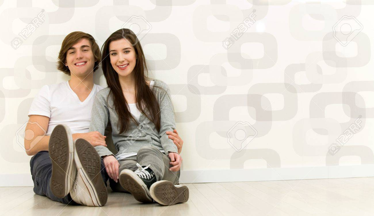 Couple sitting on the floor Stock Photo - 6389957