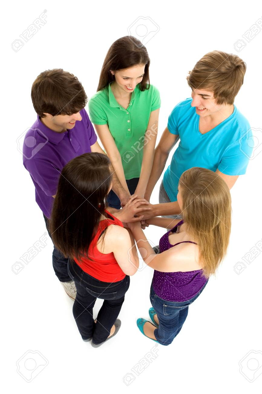 Friends putting hands together Stock Photo - 6960922