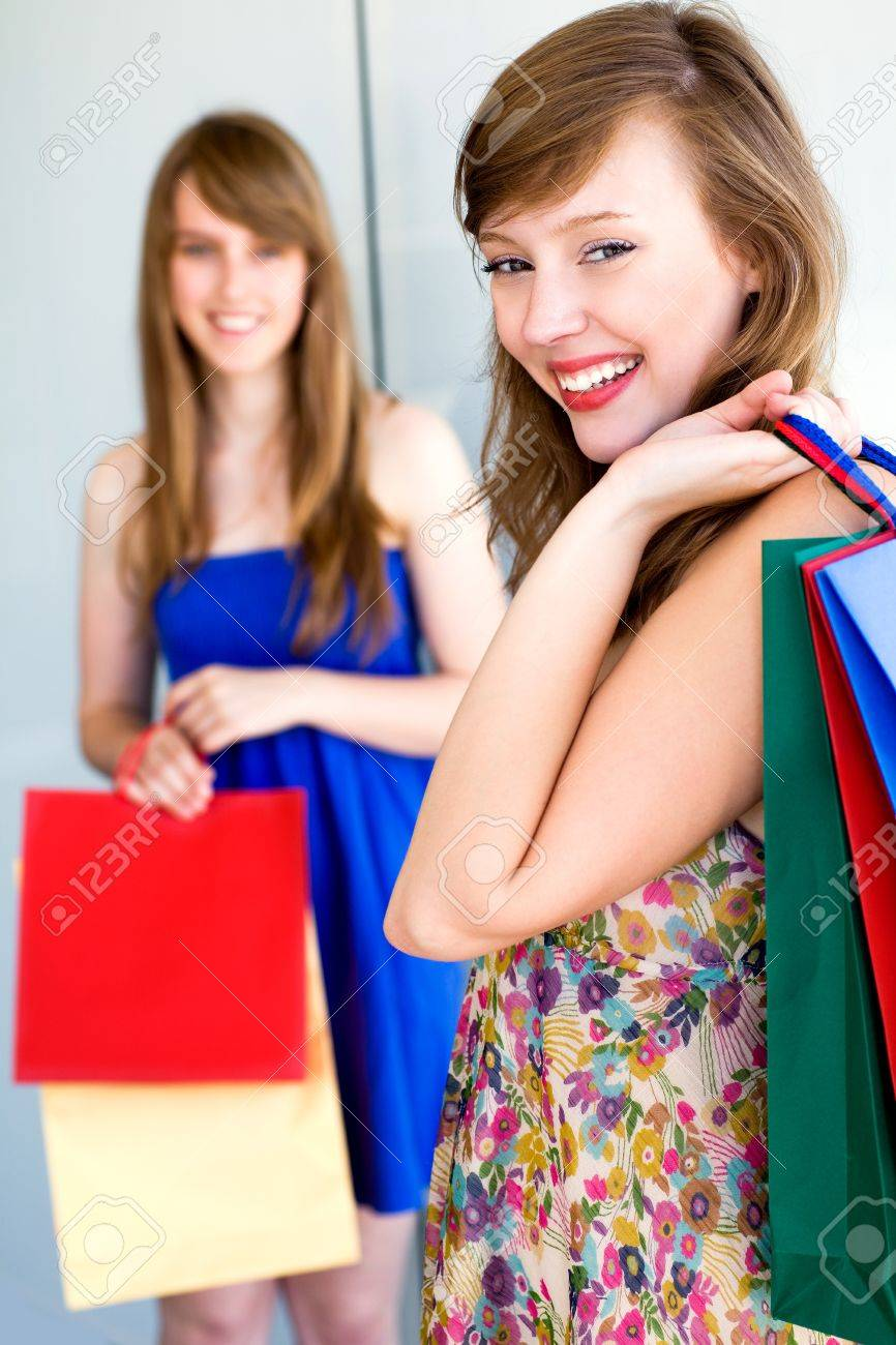 Young women with shopping bags Stock Photo - 7526136