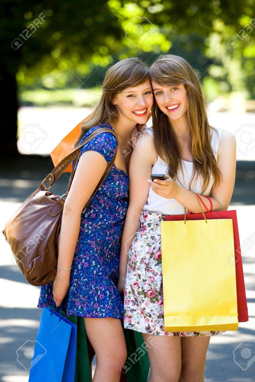 Friends with shopping bags Stock Photo - 7605339