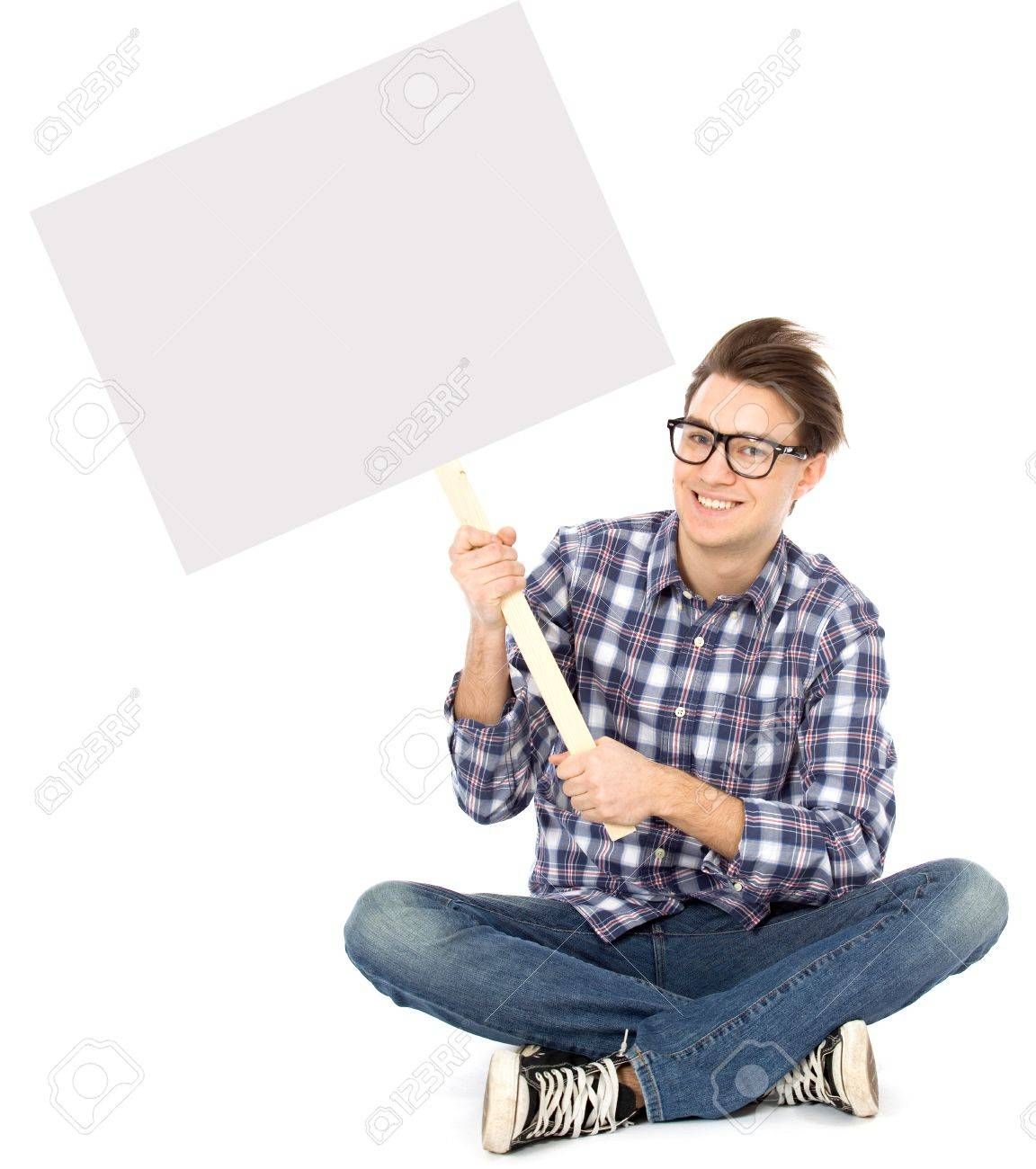 Young man holding blank poster Stock Photo - 8888105