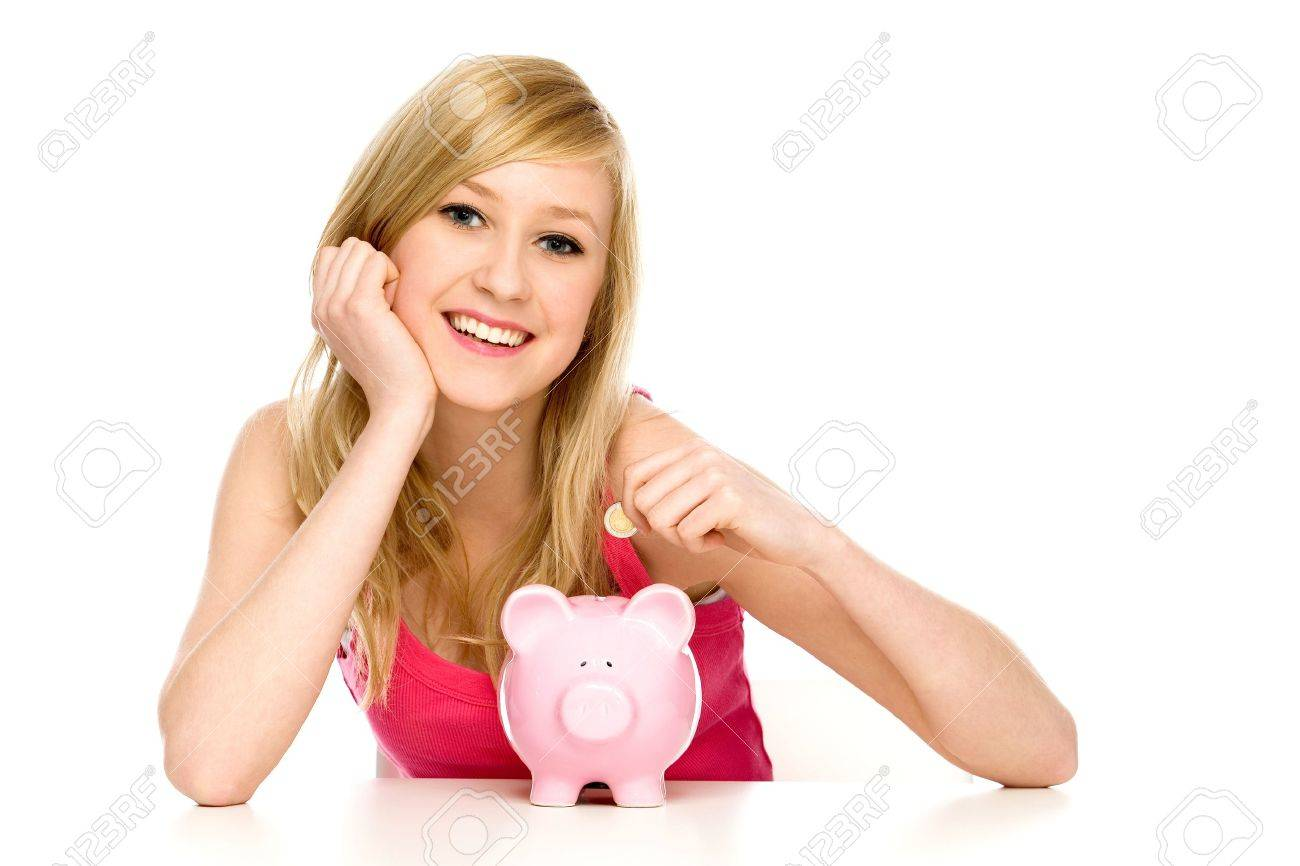Woman putting coin in piggy bank Stock Photo - 10038149