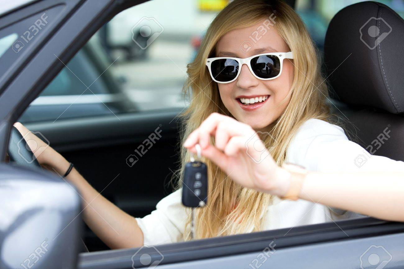 Smiling Woman Showing off New Car Keys Stock Photo - 10038179