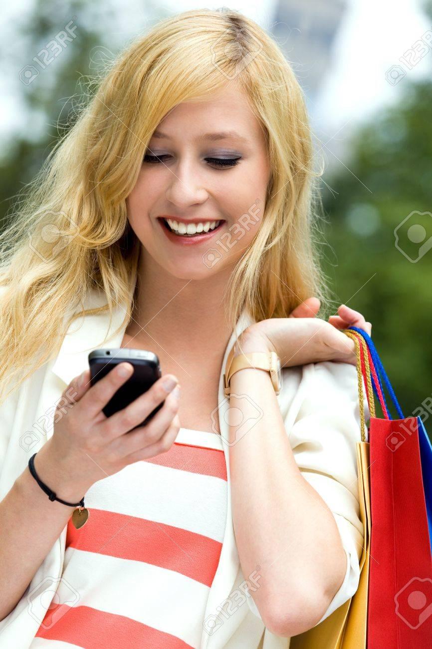 Teenage girl looking at mobile phone Stock Photo - 10038185