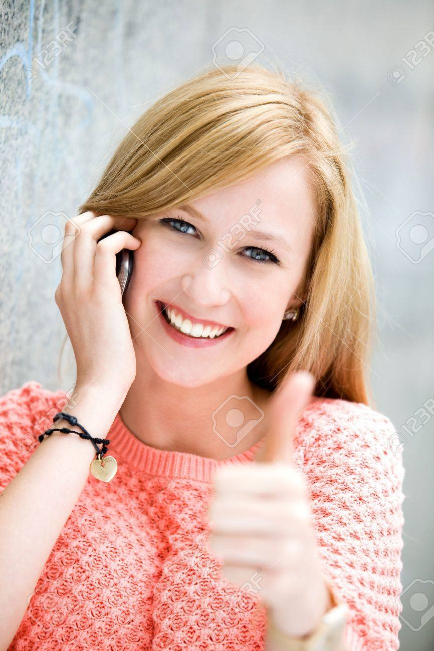 Young woman showing thumbs up Stock Photo - 10089069