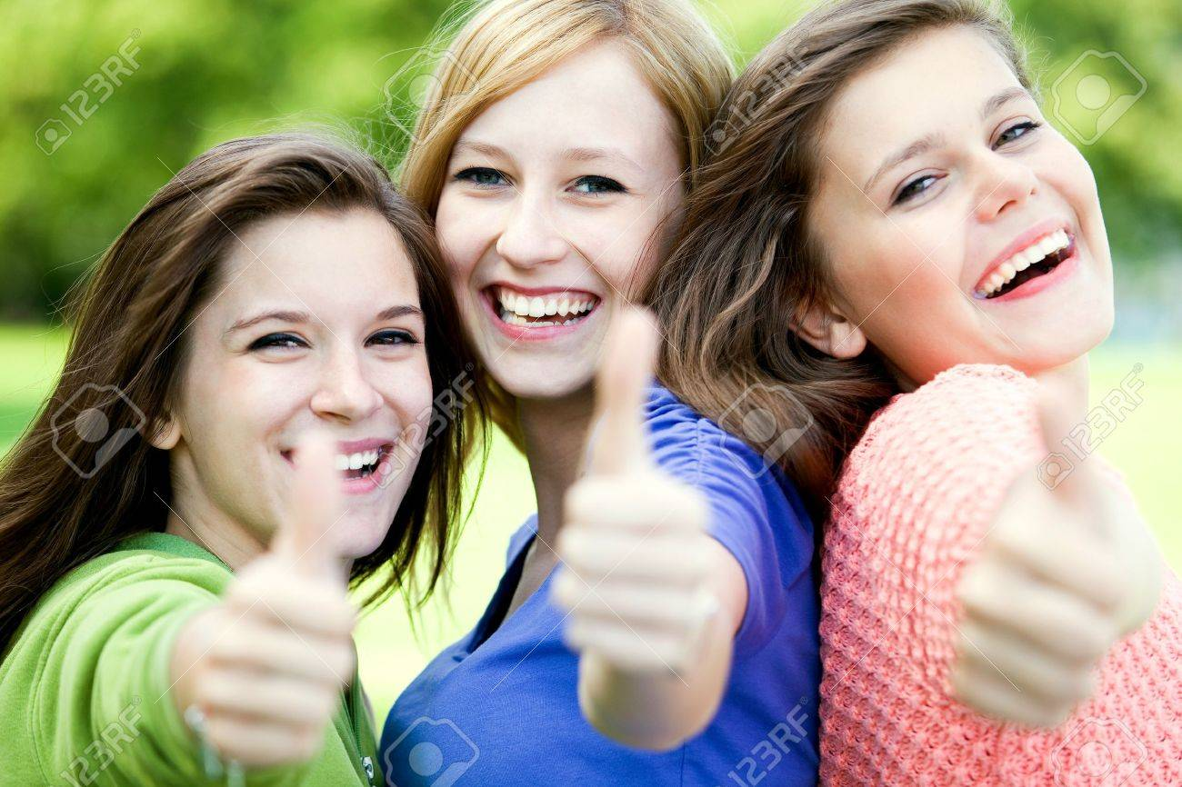 Friends with thumbs up Stock Photo - 10385687