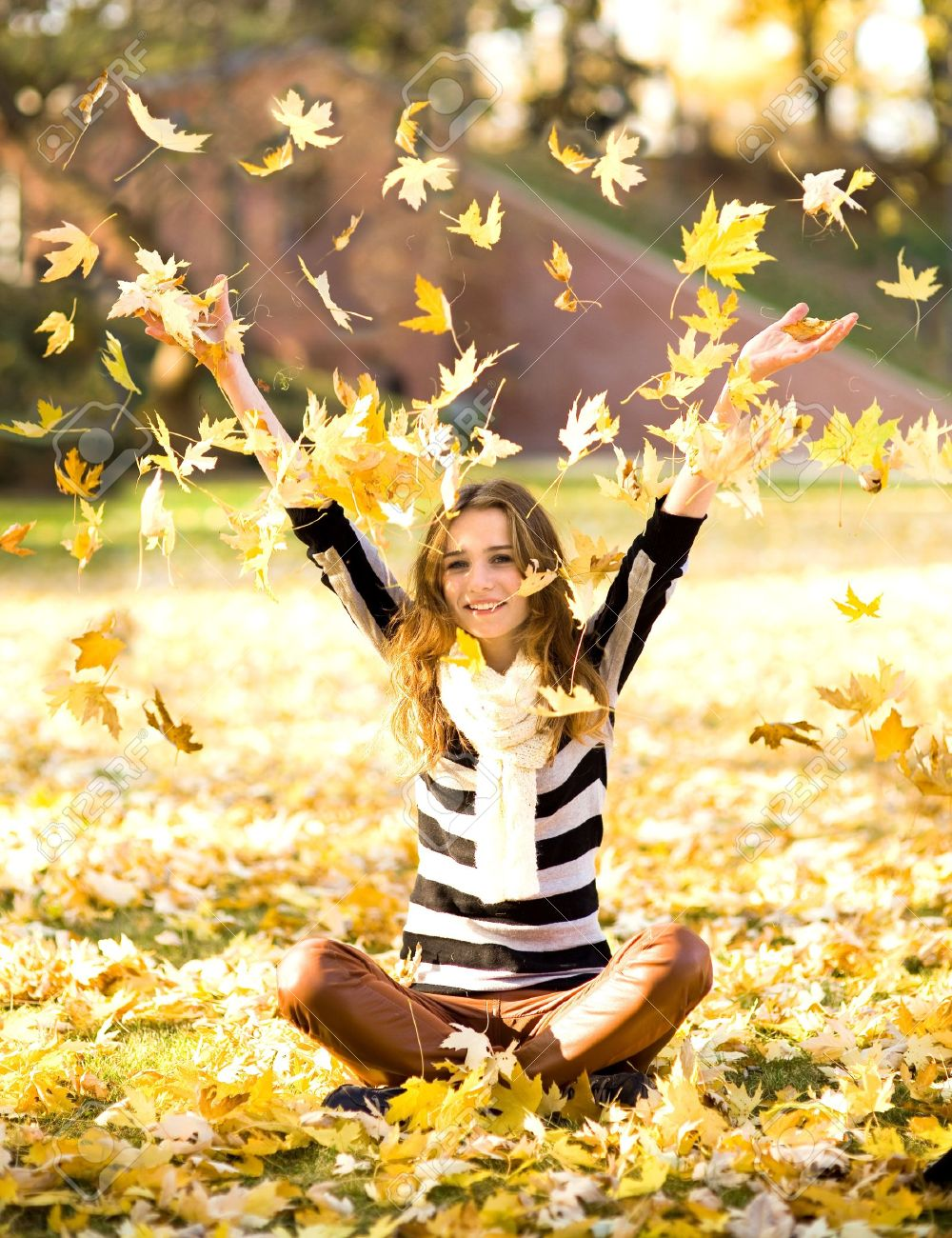 Woman throwing autumn leaves Stock Photo - 11222478