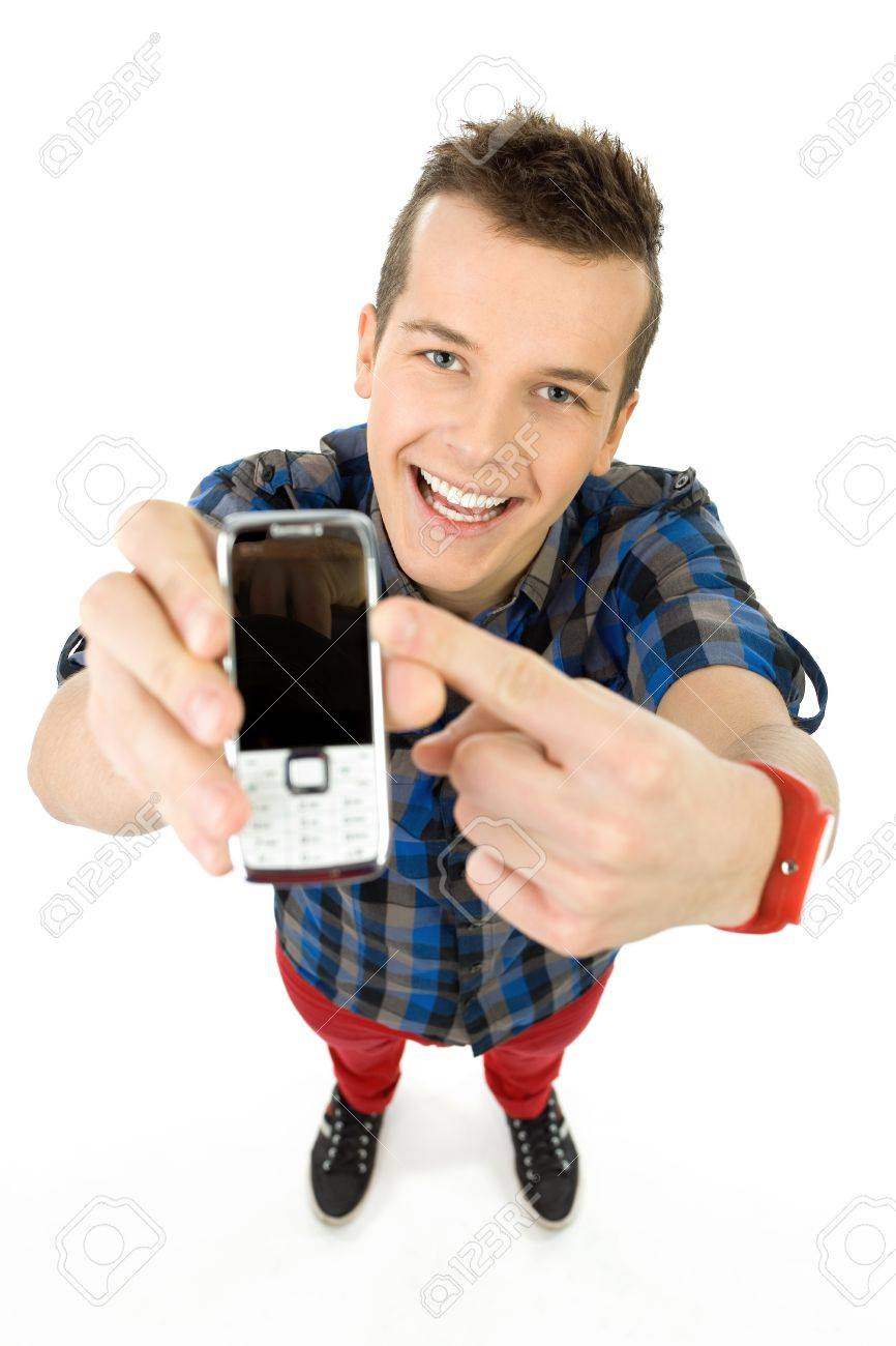 Young man showing mobile phone Stock Photo - 12378247