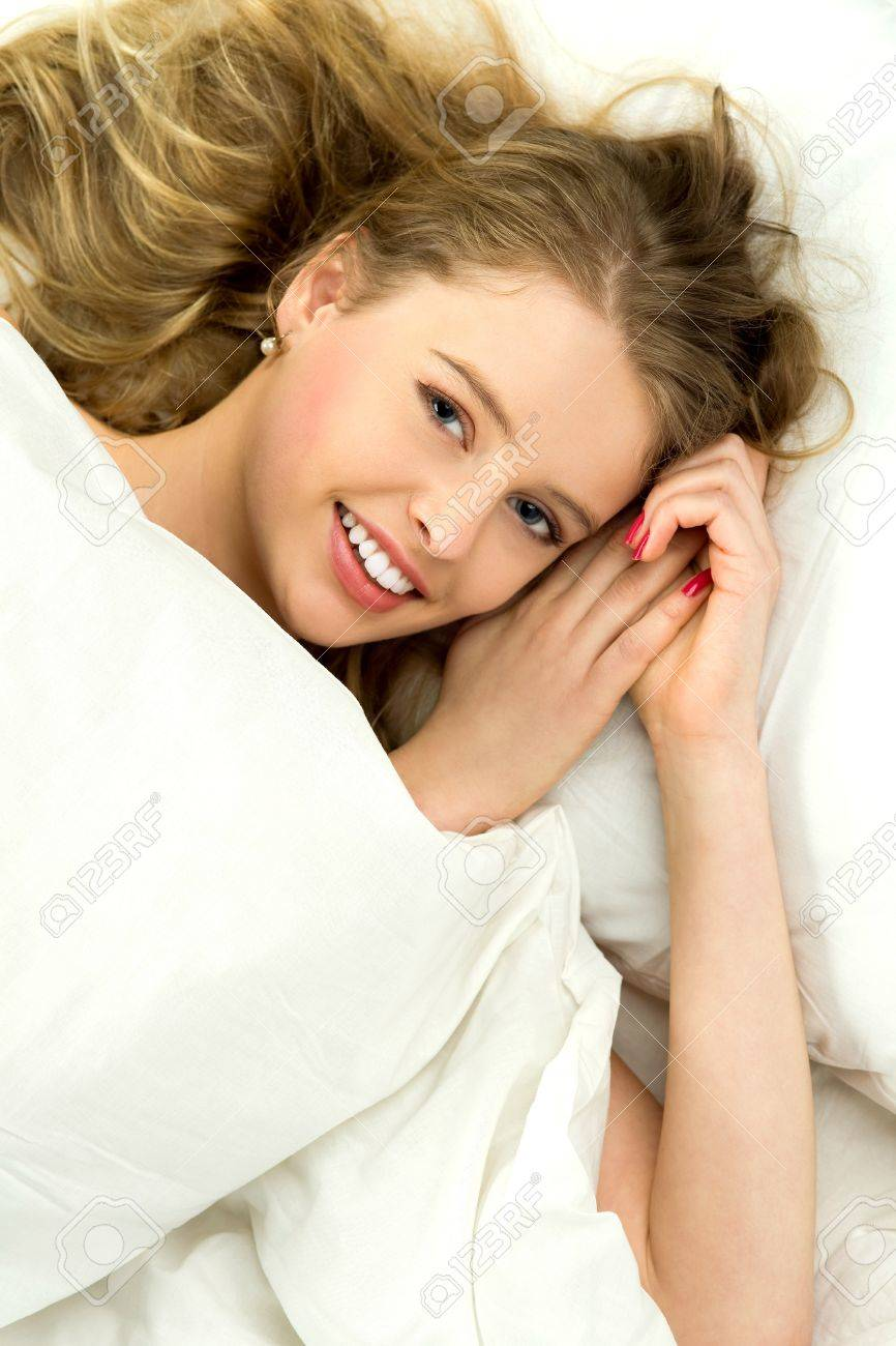 Young woman lying in bed Stock Photo - 12749873