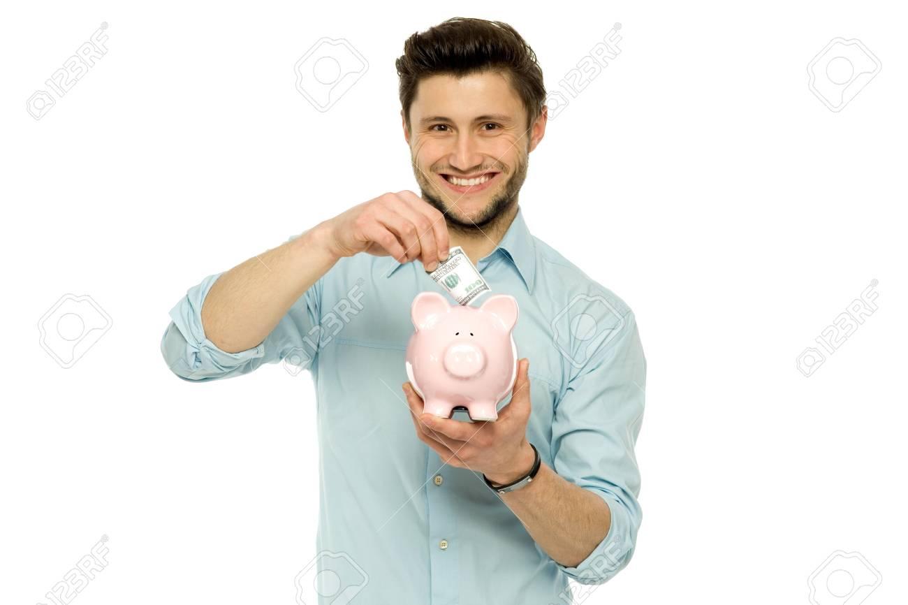 Man with piggy bank Stock Photo - 13063141