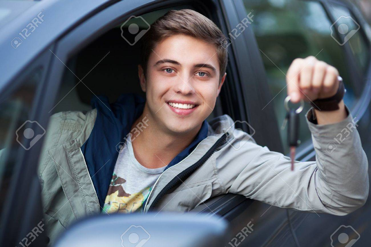 Young man sitting in car holding car keys Stock Photo - 15433466