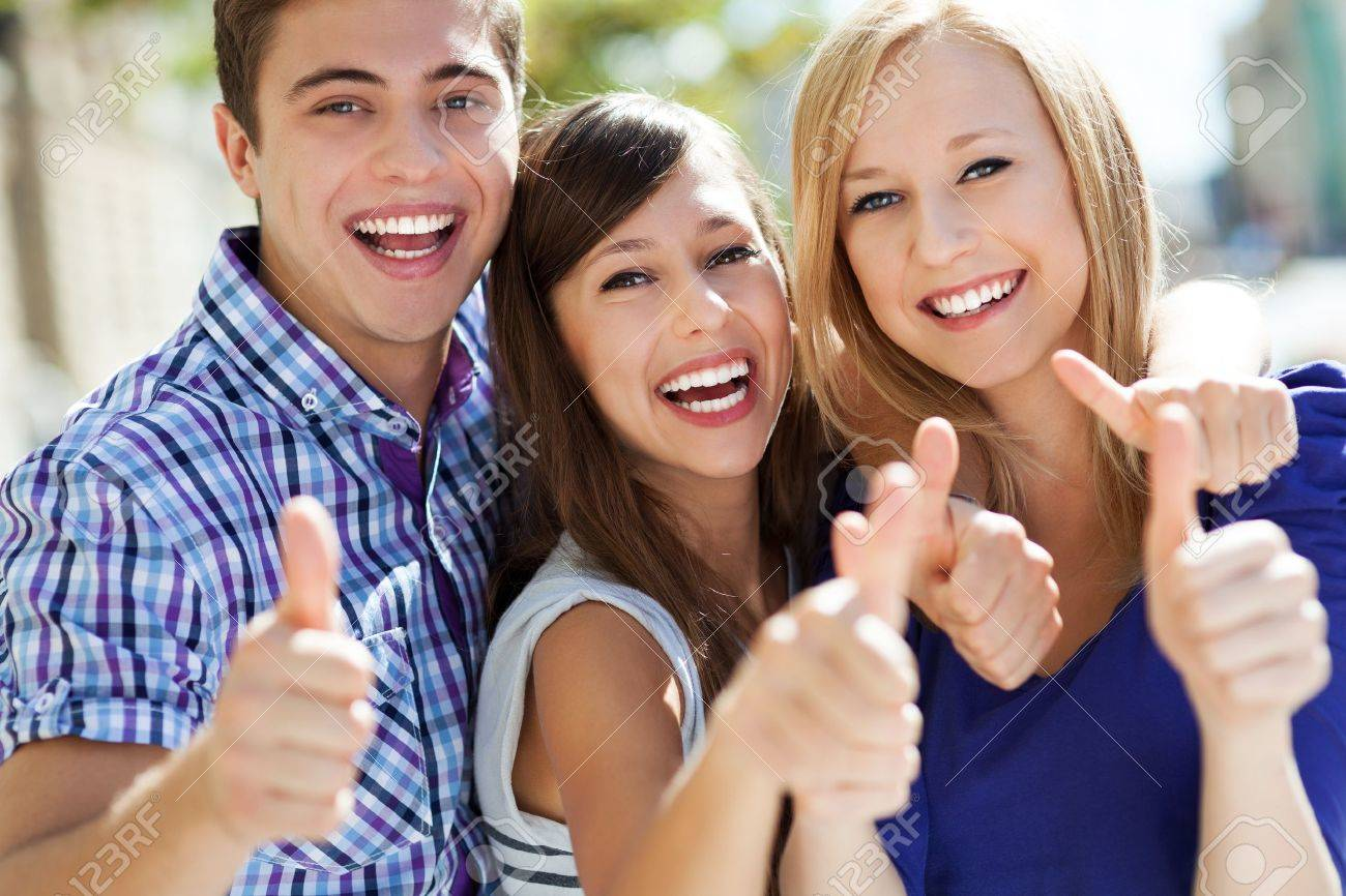 Young people with thumbs up Stock Photo - 15623110