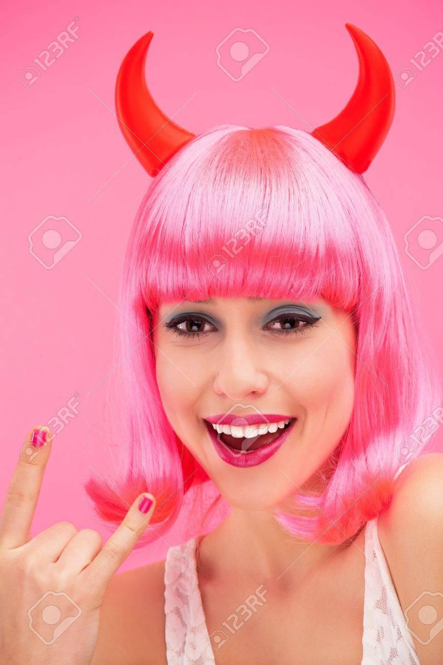 Woman wearing devil horns Stock Photo - 16827136
