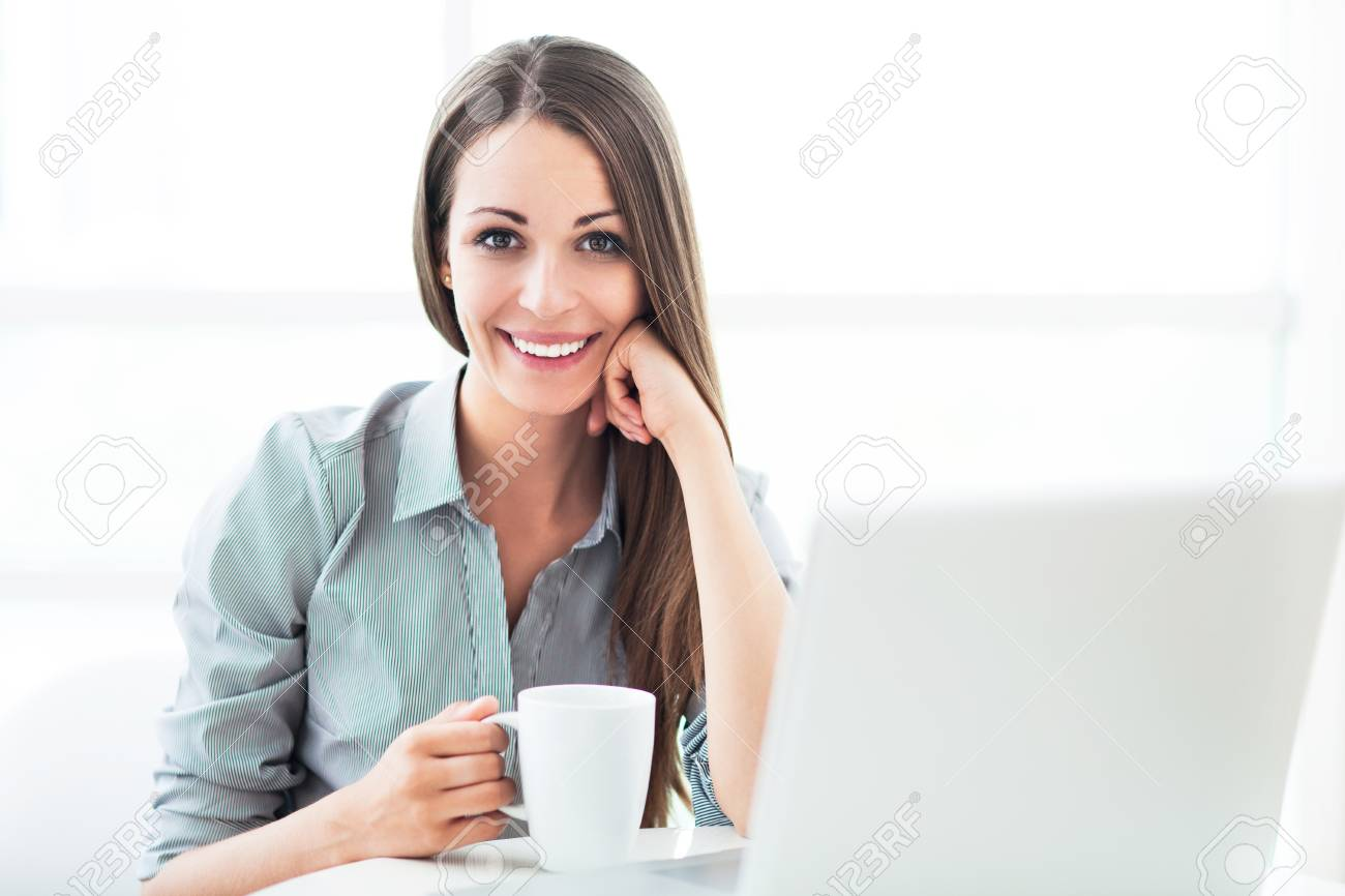 Businesswoman with laptop Stock Photo - 20275756