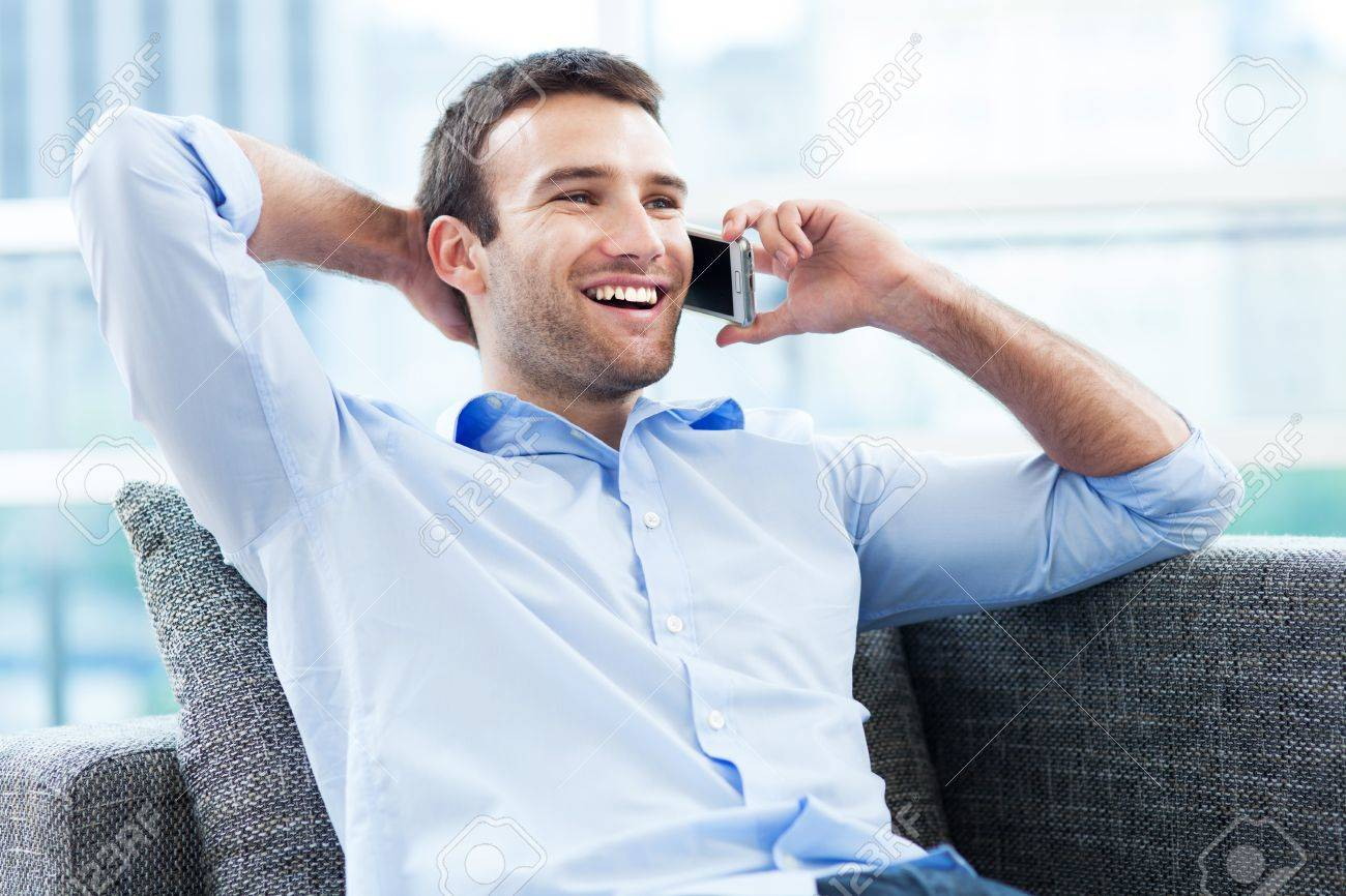 Man on sofa with mobile phone Stock Photo - 20244547
