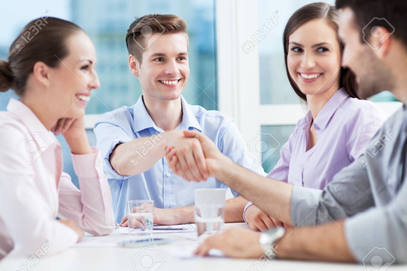 Business people shaking hands in meeting Stock Photo - 20360346