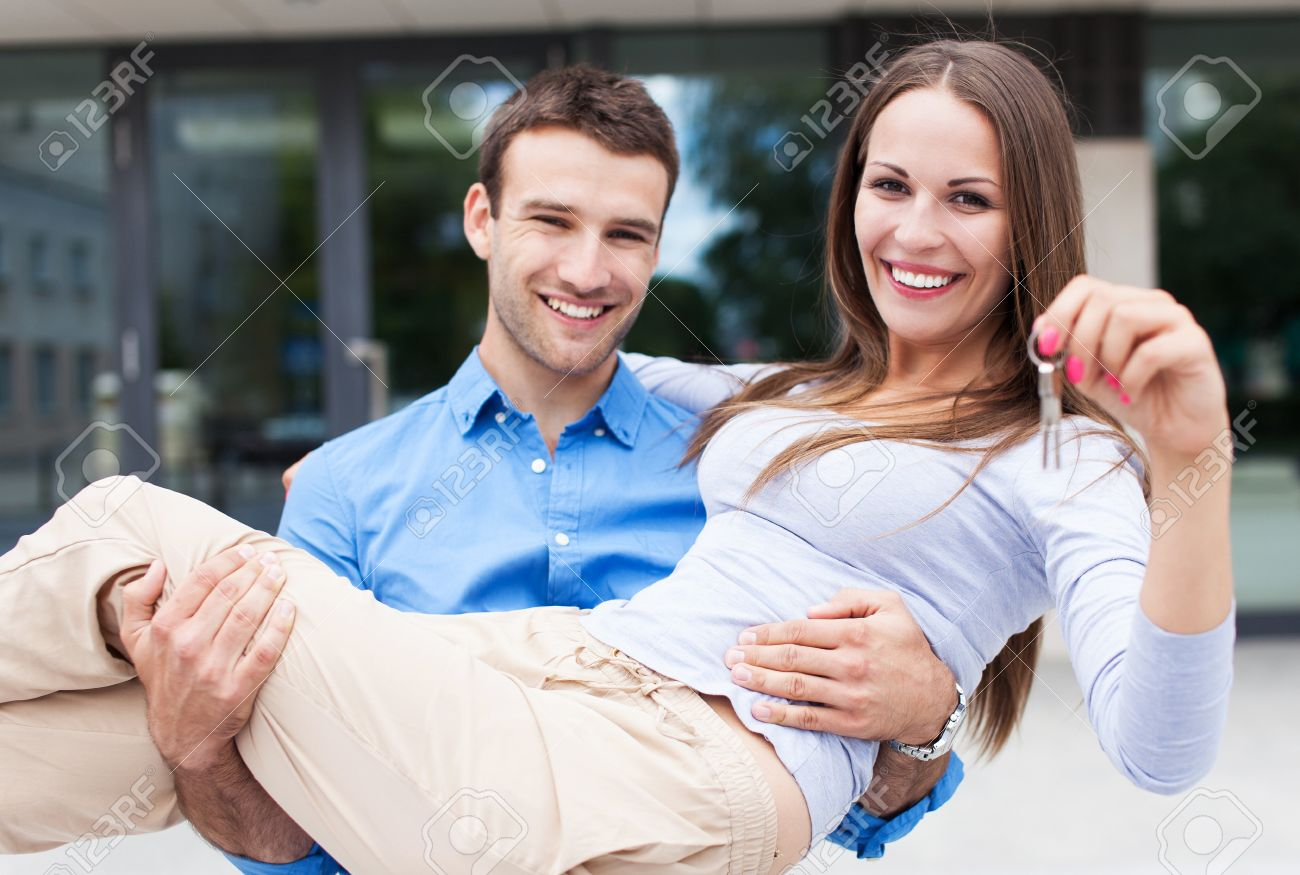 Man carrying woman into new house Stock Photo - 21330479