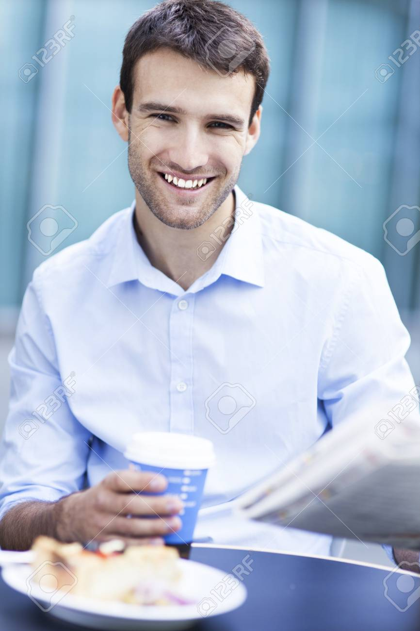 Man at outdoor cafe Stock Photo - 22699762