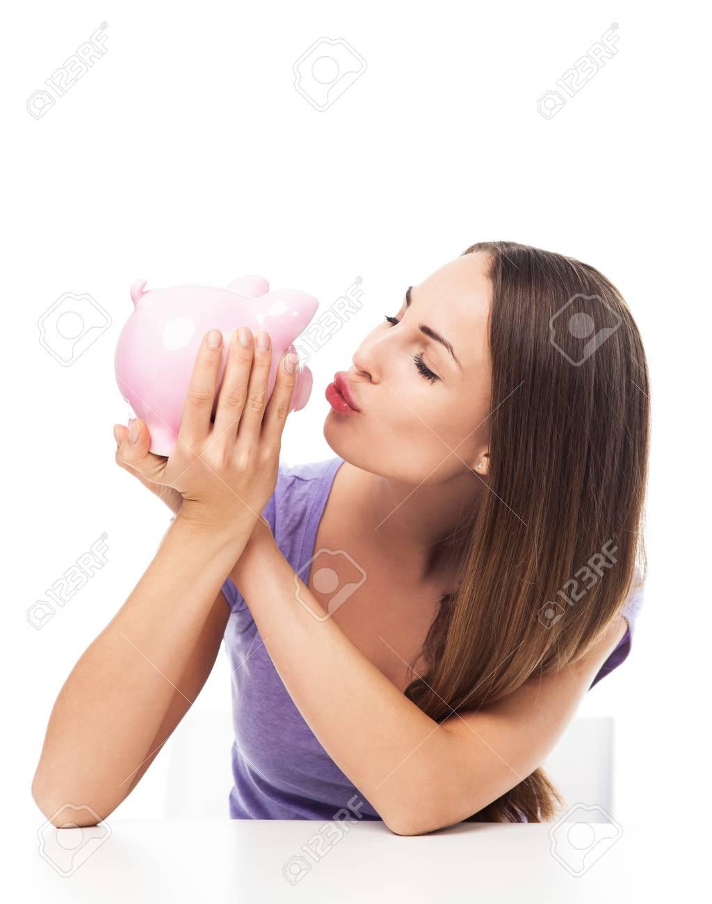Woman kissing piggy bank Stock Photo - 23807792